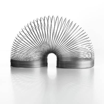Slinky Spring Art Print by Science Photo Library