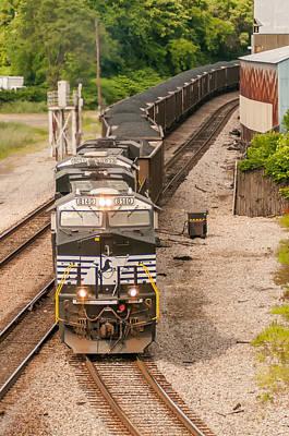 Modern Man Surf - slow moving Coal wagons on railway tracks by Alex Grichenko