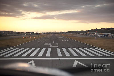 Photograph - Small Airplane Landing At Boeing Field At Sunset by Jim Corwin