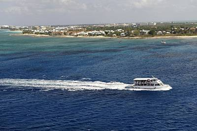 Photograph - Small Boat And Cayman Islands by Willie Harper