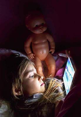 Six-year-old Girl Photograph - Small Child In Bed With Digital Tablet by Ken Welsh