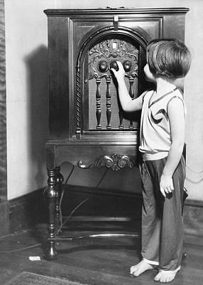 Small Girl Tuning Radio Art Print by Underwood Archives