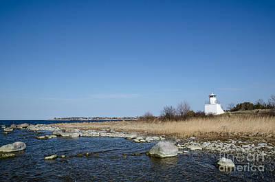 Photograph - Small Lighthouse At A Rocky Coast by Kennerth and Birgitta Kullman