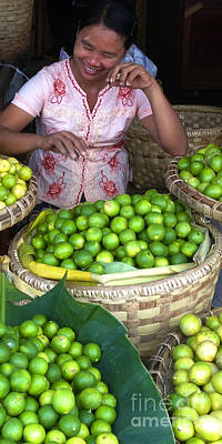 Photograph - Smiling Burmese Lady Selling Fresh Green Lemons Zay Cho Street Market 86th Street Mandalay Burma by Ralph A  Ledergerber-Photography