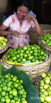 Photograph - Smiling Burmese Lady Selling Fresh Green Lemons Zay Cho Street Market 86th Street Mandalay Burma by Ralph A  Ledergerber-Photography