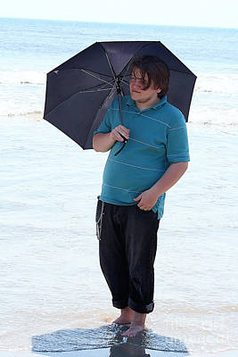 Photograph - Smiling Teen With Umbrella In Surf by Susan Stevenson