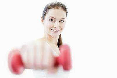 Self-confidence Wall Art - Photograph - Smiling Young Woman Holding Dumbbell by Science Photo Library