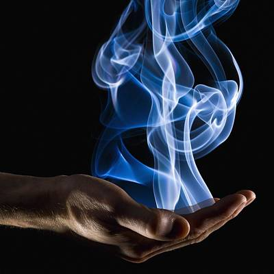 Smoke Wisps From A Hand Art Print by Corey Hochachka