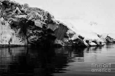 Fournier Photograph - snow covered blue ice shelf falling into the sea at Fournier Bay Antarctica by Joe Fox