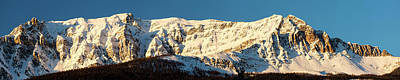 Snow Covered Mountain Lit By Warm Art Print by Michael Interisano
