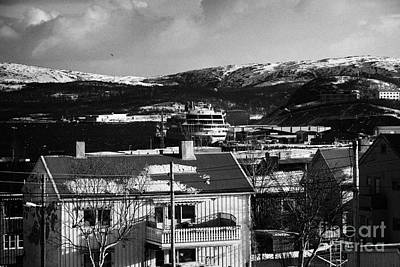 Snow Covered Street Of Traditional Wooden Houses Looking Down To Hurtigruten Ship In Kirkenes Harbou Art Print