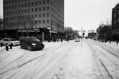 snow covered streets in downtown Saskatoon Saskatchewan Canada Art Print by Joe Fox