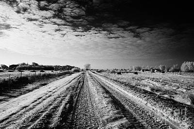 snow covered untreated rural small road in Forget Saskatchewan Canada Art Print by Joe Fox