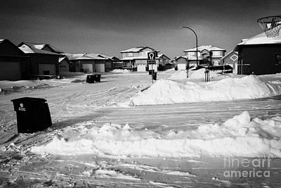 snow covered upmarket residential street during winter Saskatoon Saskatchewan Canada Art Print by Joe Fox