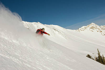 Black Diamonds Photograph - Snowboarder Enjoys The Powder by Howie Garber