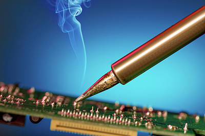 Electronic Photograph - Soldering An Circuit Board by Wladimir Bulgar