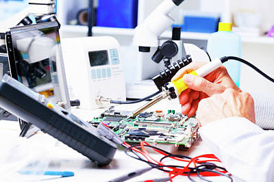Soldering Equipment And Circuit Board Art Print by Wladimir Bulgar
