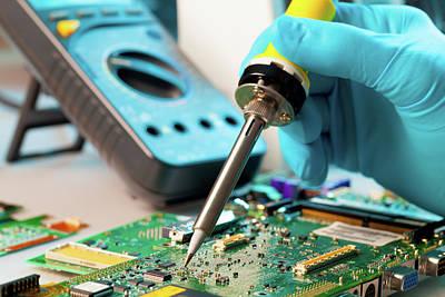 Microchip Photograph - Soldering Microchip by Wladimir Bulgar