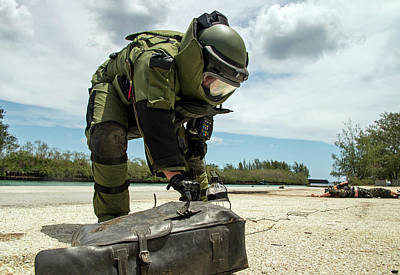 Improvised Explosive Device Photograph - Soldier Dressed In Bomb Suit Inpecting by Stocktrek Images