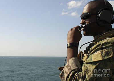 Soldier Instructs Small Boat Maneuvers Print by Stocktrek Images