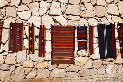 Jordan Souvenirs Photograph - Souvenir Rugs For Sale At Wadi Mujib Jordan by Robert Preston
