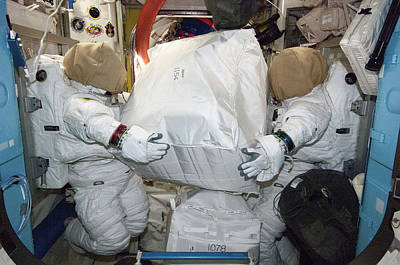Spacesuit Photograph - Spacesuits On The Iss by Nasa
