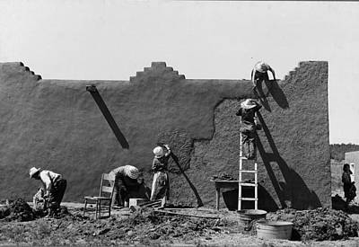 Photograph - Spanish American Women Replastering An Adobe House by Historic Photos