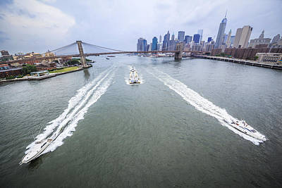 Photograph - Speed Boats And Barge At East River In Front Of The Brooklyn Bridge And Manhattan Skyline by Alex Potemkin