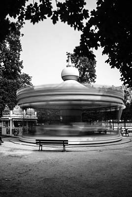 Photograph - Spinning Carrousel #2 by Marinus Ortelee