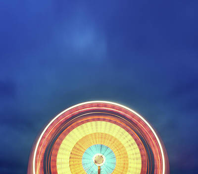 Photograph - Spinning Ferris Wheel by Shaunl