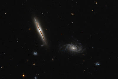 Photograph - Spiral Galaxies by Science Source