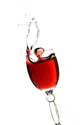 Wine Cellar Photograph - Splashing Glass Of Red Wine by Andreas Berheide