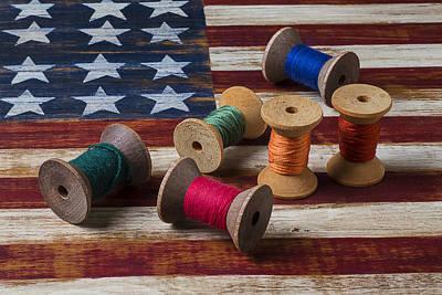 Thread Art Photograph - Spools Of Thread On Folk Art Flag by Garry Gay