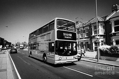 Stratford Photograph - stagecoach red double deck bus in london suburbs London England UK by Joe Fox