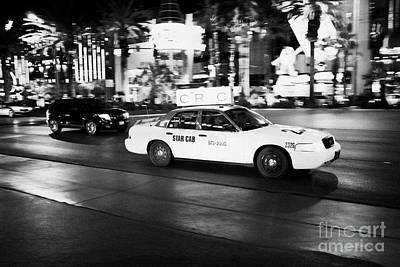 Speeding Taxi Photograph - star cab speeding down Las Vegas boulevard at night Nevada USA deliberate motion blur by Joe Fox