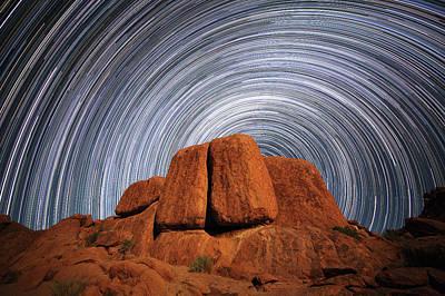 Star Trails Above A Large Boulder Art Print by Robert Postma