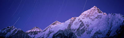 Star Trails Over Snowcapped Nuptse Art Print by Panoramic Images