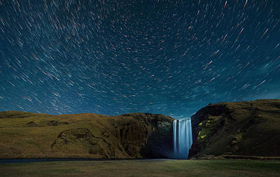 Photograph - Startrails Over Iceland Waterfall by Noppawat Tom Charoensinphon