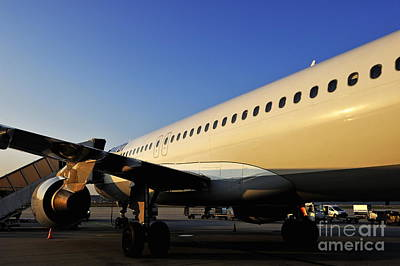 Stationary Airplane On Tarmac At Sunrise Art Print by Sami Sarkis