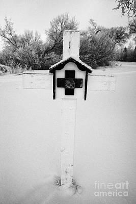 stations of the cross in a graveyard during winter in Forget Saskatchewan Art Print by Joe Fox