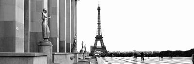 The Eiffel Tower Photograph - Statues At A Palace With A Tower by Panoramic Images