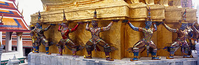 Statues At Base Of Golden Chedi, The Art Print by Panoramic Images