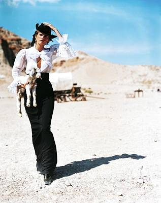 Fashion Photograph - Stella Tennant Carrying A Lamb by Arthur Elgort