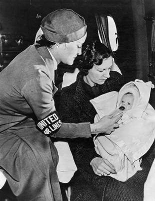 Caring Mother Photograph - Stewardess Feeding Baby by Underwood Archives