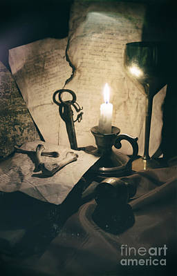 Still Life With Bones Rusty Key Wine Glass Lit Candle And Papers Art Print