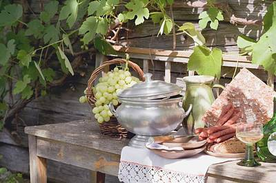Wooden Ware Photograph - Still Life With Grapes, Bread, Sausages And Wine In Front Of Farmhouse by Eising Studio - Food Photo and Video