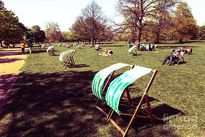 Photograph - Still Some Vacant Deck Chairs In Hyde Park London During Early S by Peter Noyce