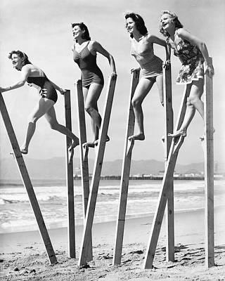 Photograph - Stilt Walking On The Beach by Underwood Archives