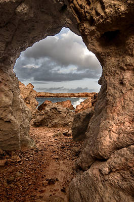 Photograph - A Natural Stone Arch In North Coast Of Minorca Appears Like A Pass To One Thousand And One Night  by Pedro Cardona