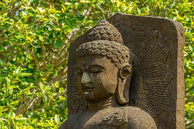 Stone Buddha Amongst Green Leaves Art Print